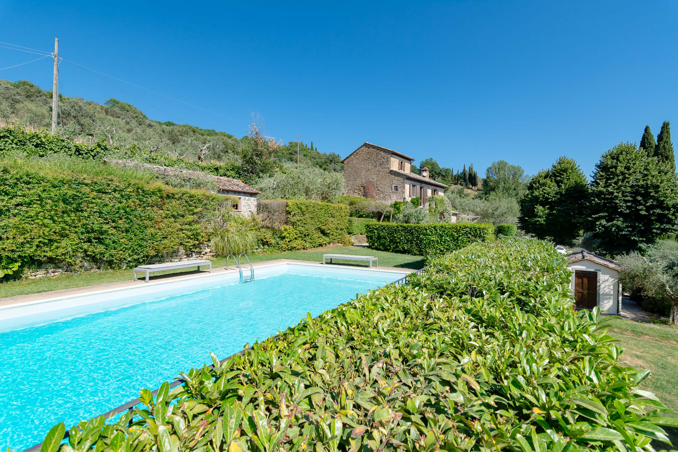 Secular farmhouse overlooking Cortona and swimming pool.